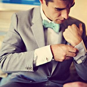 groom-putting-on-cufflinks