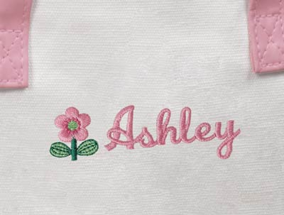 Your flower girl's name will be embroidered in pink right next to a pretty flower.