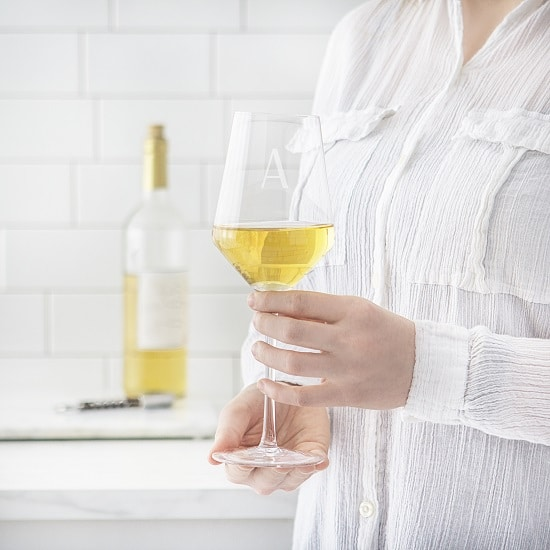 Bridesmaid toasting with a custom white wine glass