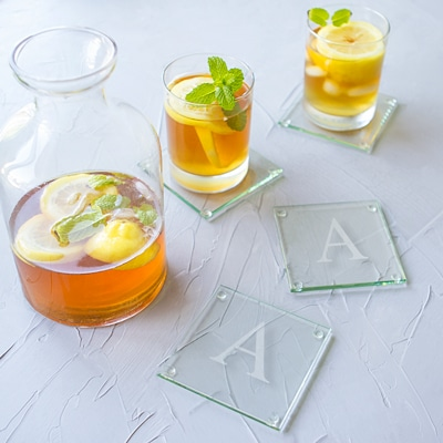 Wow your guests by serving them a cold drink on our personalized glass coasters.