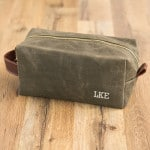 We'll embroider up to three initials on the olive green or black dopp kit.