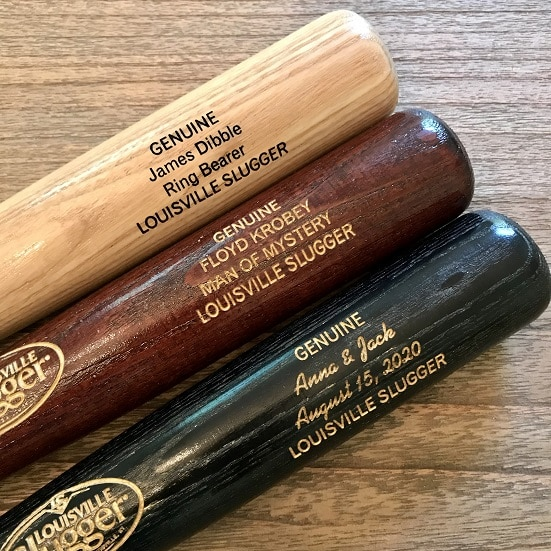 Custom Mini Louisville Slugger Bats are available on The Man Registry in natural, black and Hornsby colors. Choose from script or block print font for your groomsmen names.