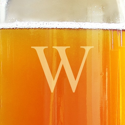 Drinking beer from a beer growler that's engraved with a W.