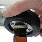 The bottom of the puck opens beer bottles with ease