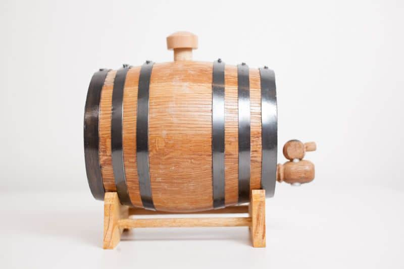 Side view of mini bourbon barrel with stand, bung and spigot