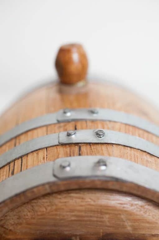 Top of mini bourbon barrel with silver hoops and bung