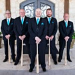 Wedding party groomsmen holding baseball bats