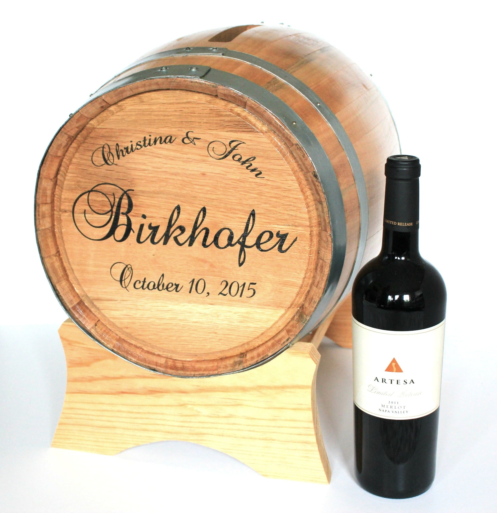 Card Holder Barrel with engraving example and next to Artesa bottle of wine