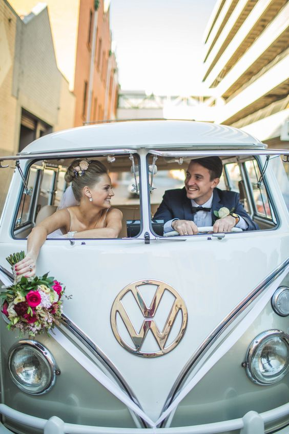 bride and groom in vw bug getaway car