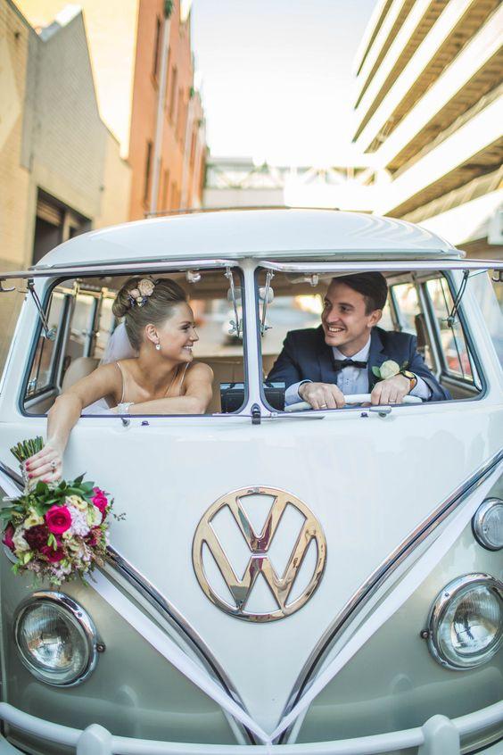 bride and groom in vw bug getaway car