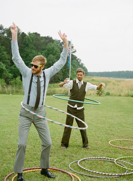 groomsmen hula hooping