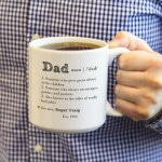 Dad proudly sipping coffee from his mug