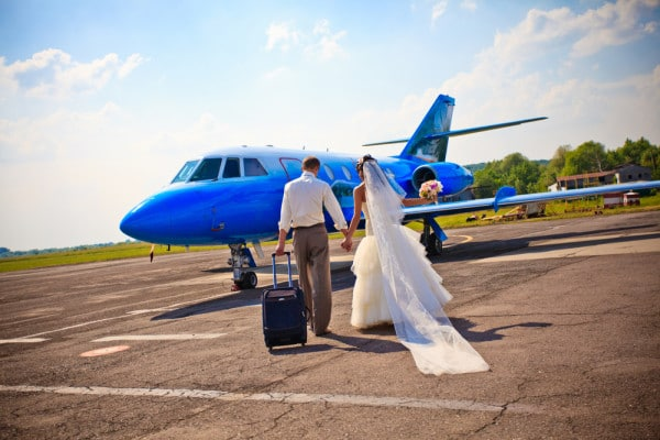 bride and groom conquering a fear of flying before the honeymoon