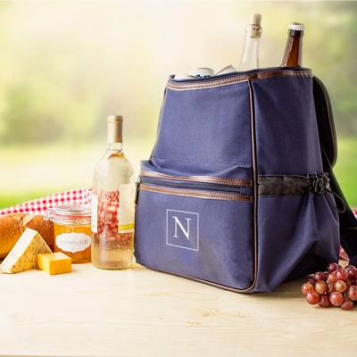Backpack cooler shown with a single initial personalized on the front