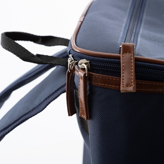 The faux leather accents are a nice touch to the backpack cooler.
