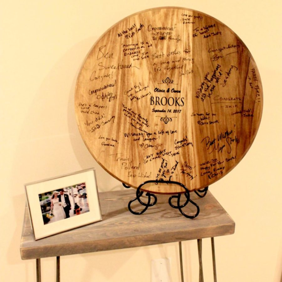 Wedding guests will sign this wine barrel guest book with a sharpie.