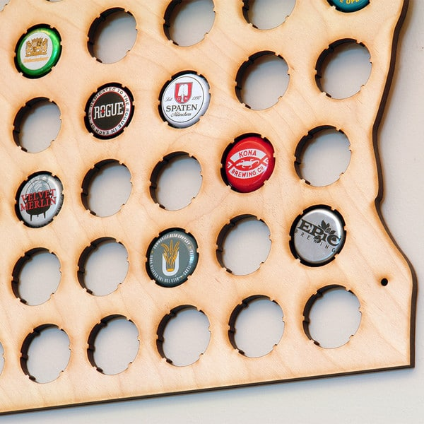 bottle caps easily slide into pre-cut holes in the map