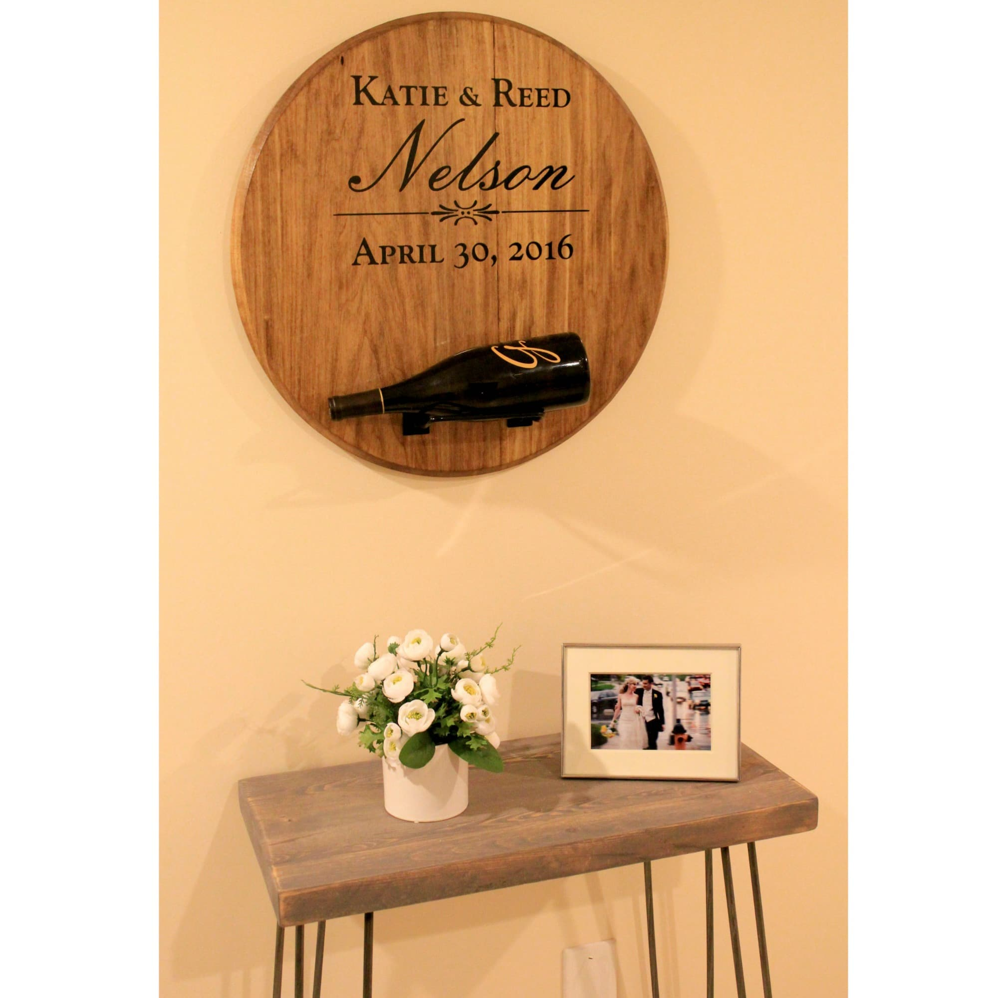 personalized wedding wine holder hanging above an entry table