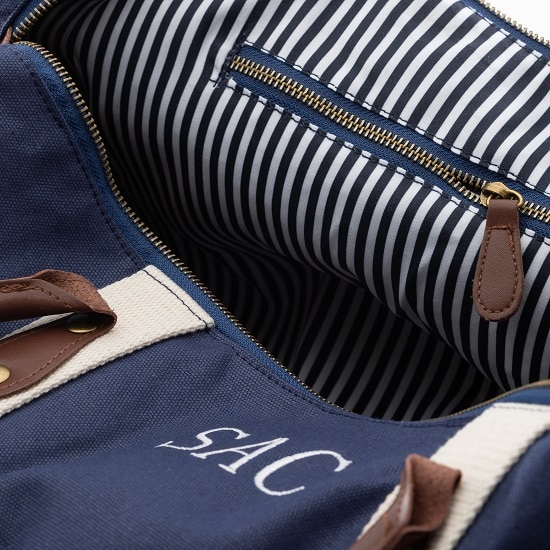 Handsome striped interior of the blue canvas & leather duffle bag