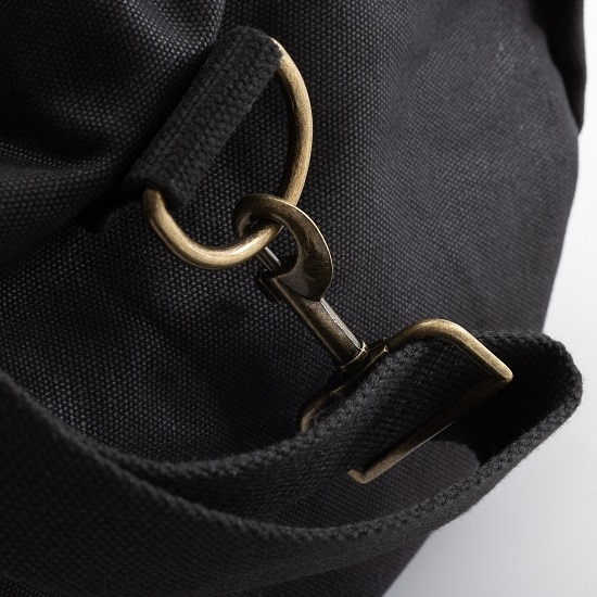 Hardware close-up on the black canvas & leather duffle bag