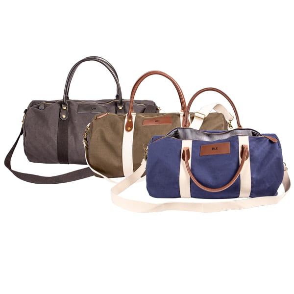 This stylish canvas and leather duffle bag — available in black, green or blue — includes leather handles, an adjustable cotton shoulder strap, as well as a roomy interior sporting a zippered pocket and a menswear-inspired striped pattern.