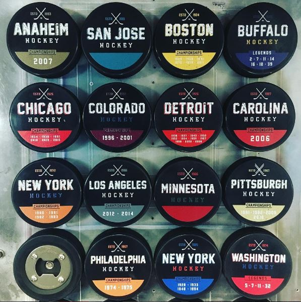 Hockey puck bottle openers that commemorate each city's Stanley Cup wins.
