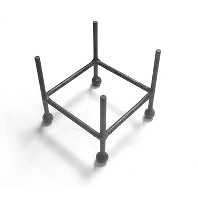 Rust iron display stand holds 4 coasters.