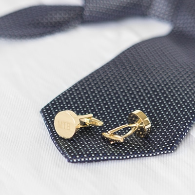 Free laser engraving is offered on the gold cufflinks.