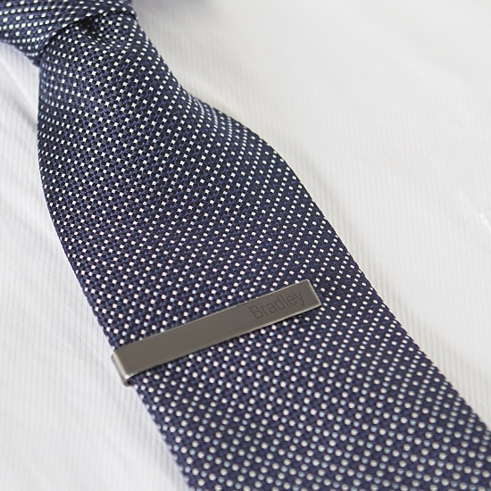 The gunmetal tie bar easily attaches to any size tie.
