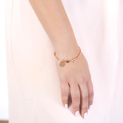 A bride's hand to her side as she sports the Personalized Wire Bracelet