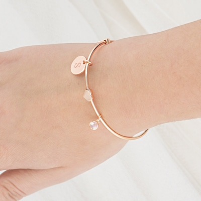 Three charms adorn the bracelet.