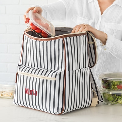 Woman Putting Food Inside A Personalized Striped Backpack Cooler