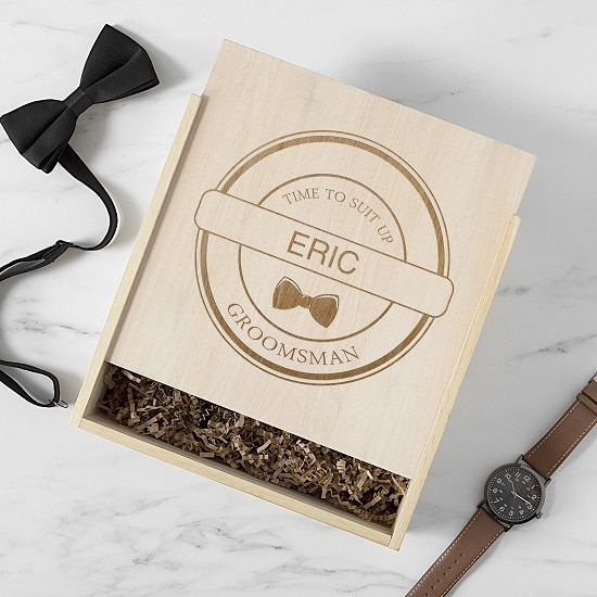 Groomsman gift box filled with gifts like bow tie and watch
