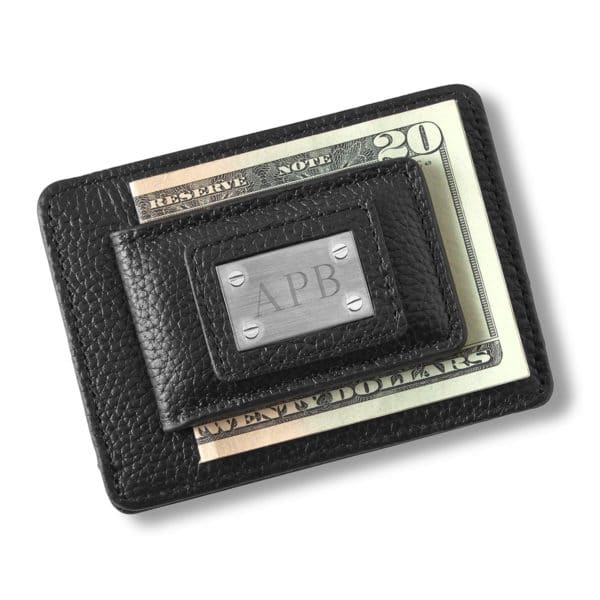 A black leather money clip card holder that we'll engrave for the groomsmen.