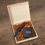 Your groomsmen will cherish the flask that is printed with their initials.