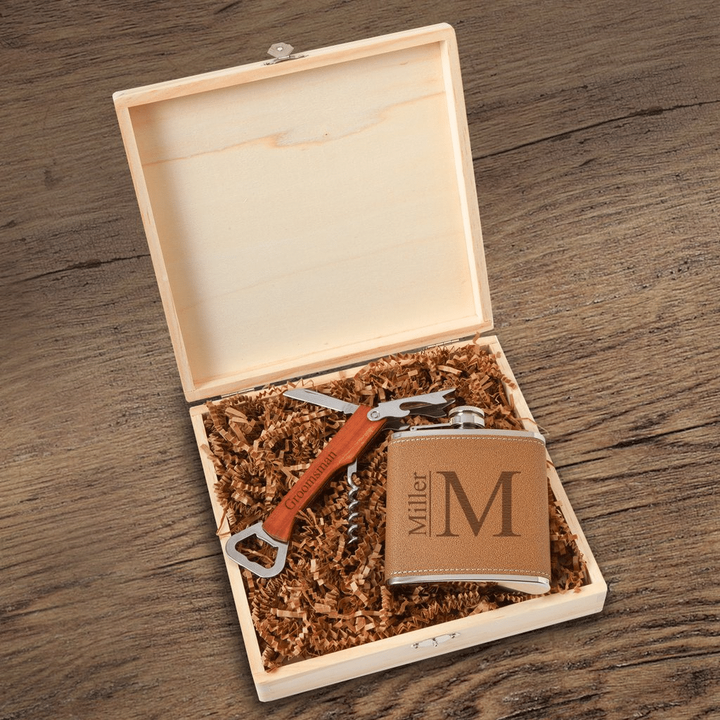 Modern monogram engraved on a groomsman gift box.