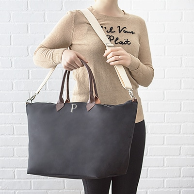 A bridesmaid holding her 2330BK weekender tote gift.