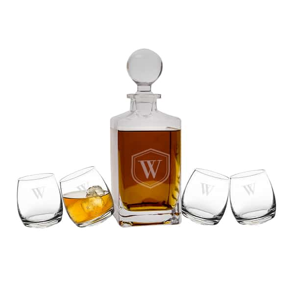 "Engraved whiskey decanter with four ""tipsy"" swiveling rocks glasses."