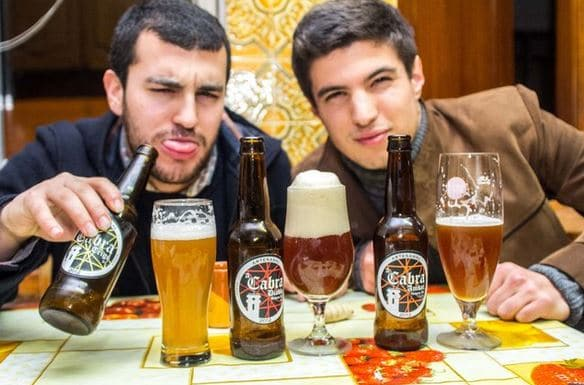 two friends enjoying a beer together