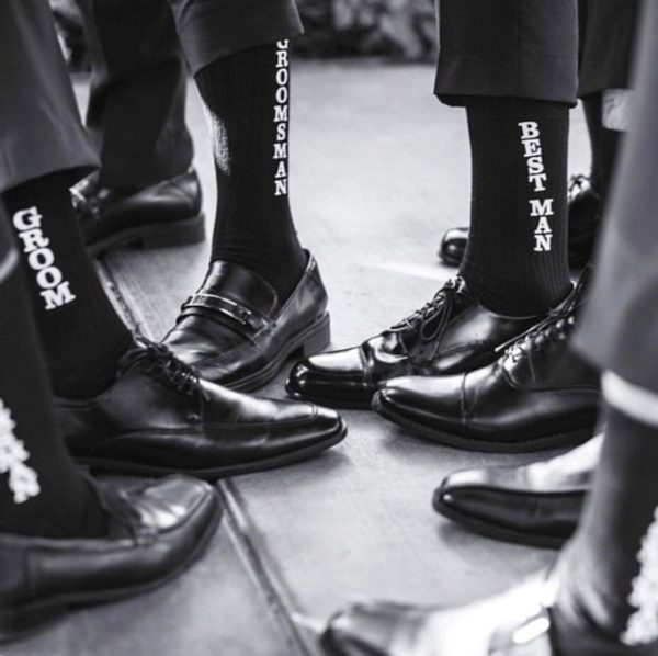 Wedding photos with groom and groomsmen wearing matching socks