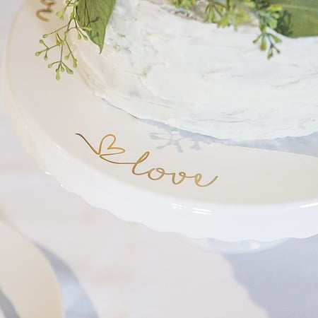 The word love is printed in golf foil around the top of the cake stand.
