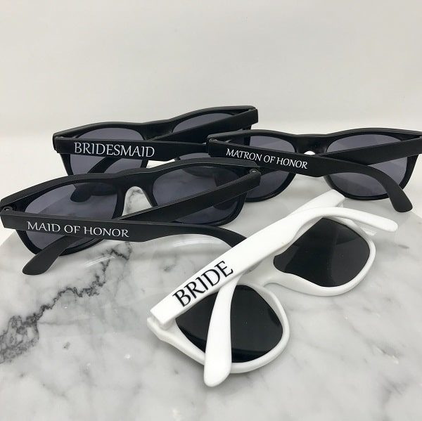 Matching sunglasses for the bride, bridesmaids, maid of honor and matron of honor.
