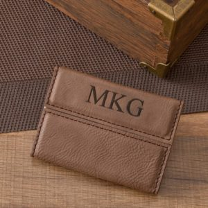 A mocha-brown simulated leather business card holder for your groomsmen.