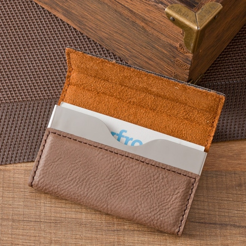 The 4 x 2 business card holder features a classy suede interior