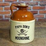 Glass jug that holds 750 ml of your groomsman's homemade moonshine