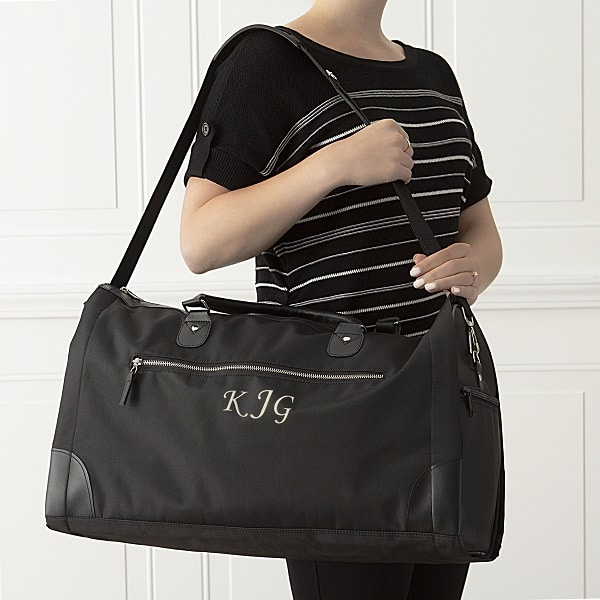 A black convertible garment bag for your bridesmaids to travel to the wedding with.