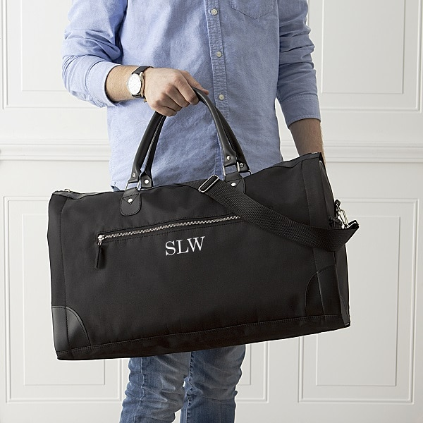 A black convertible garment bag for your groomsmen to travel to the wedding with.
