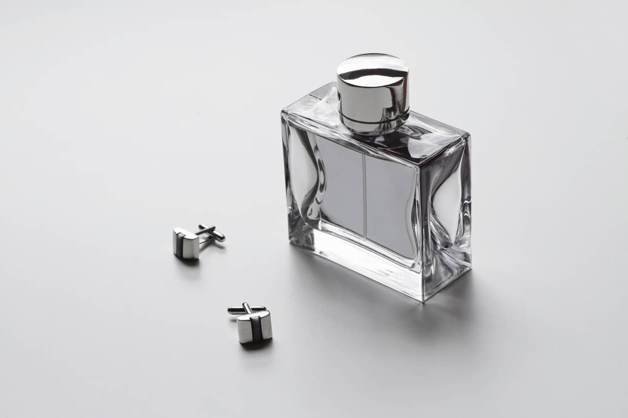 Horizontal mens cologne and cufflinks monochrome