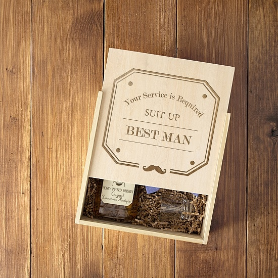 The lid slides open to reveal awesome best man gifts inside the craft.