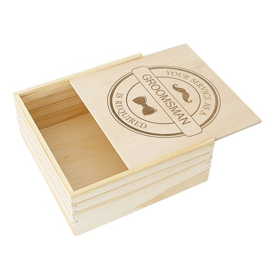 The pine wood groomsman box features a convenient sliding lid.